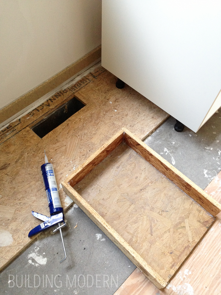 Redirecting a vent register under a cabinet