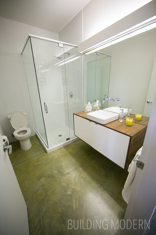 Green Tinted Concrete Floors in a Bathroom