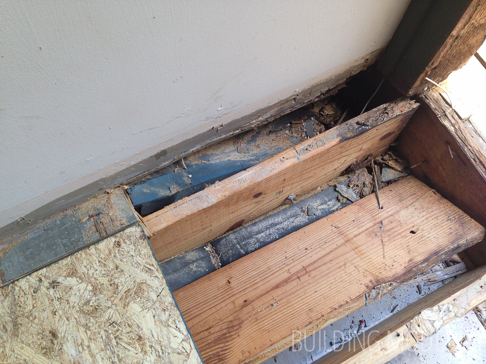Joists near the front door with slight water damage