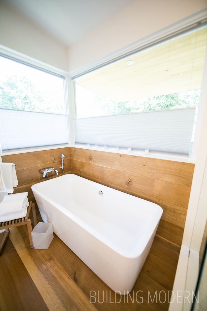 Free standing soaking tub with wood surround
