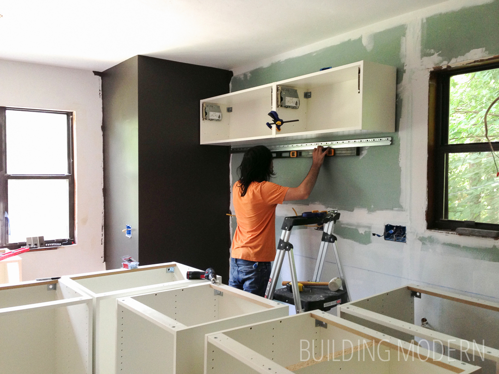 Installing upper Ikea kitchen cabinets. Ikea kitchen cabinet installation