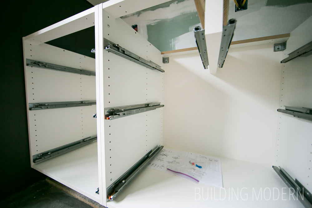 Interior of an Ikea kitchen cabinet with drawer slides