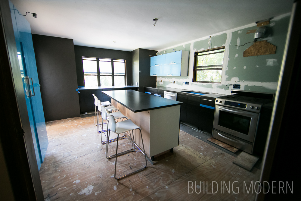 new kitchen concrete countertops in a 1980 contemporary house