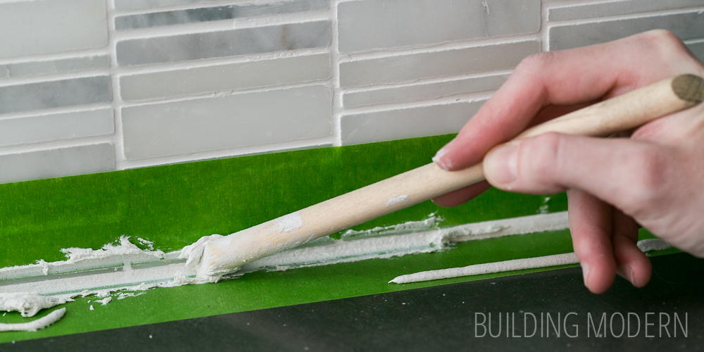 Finishing touches on the backsplash: caulk