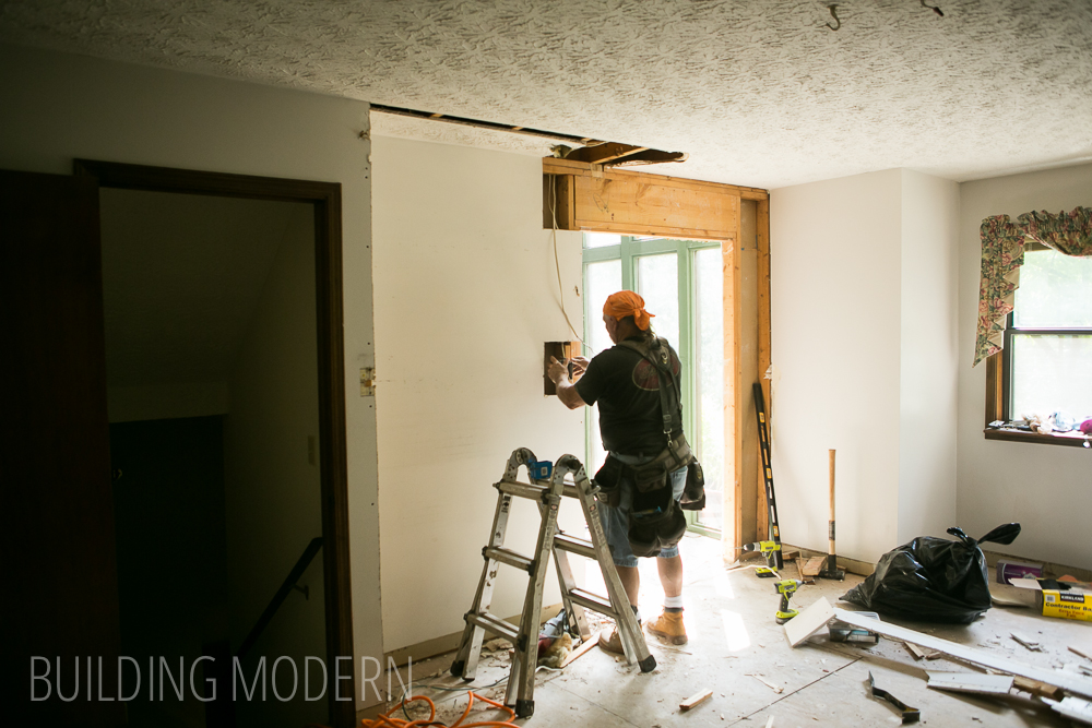 extending a door opening and moving electrical