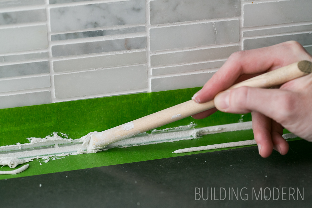 how to caulk a backsplash