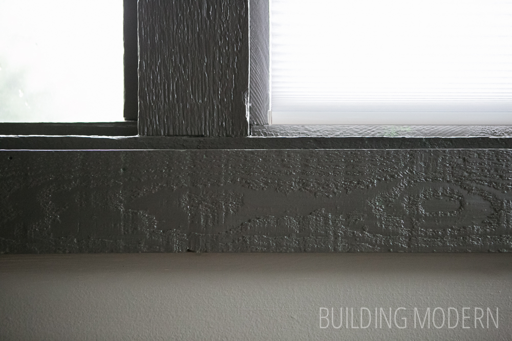 Medium warm gray walls with dark charcoal trim