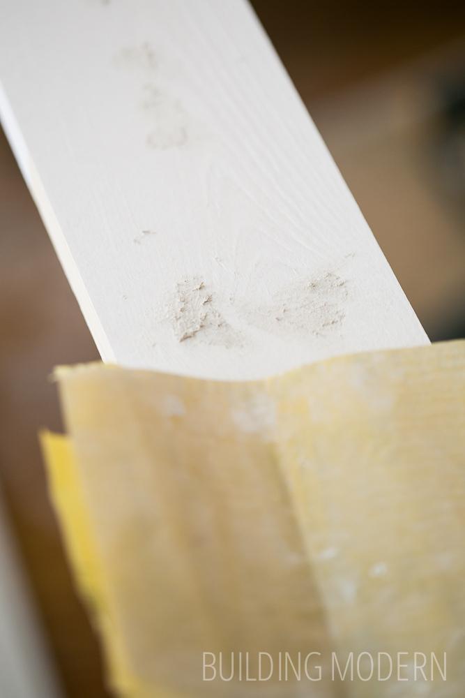 sanding baseboards
