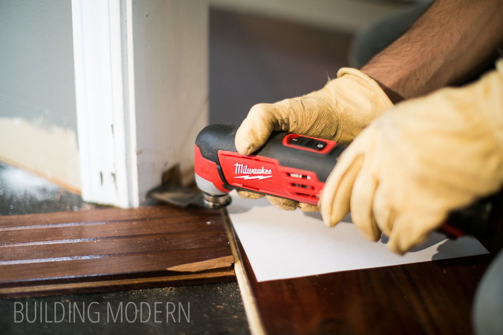 using a multi tool on a door frame
