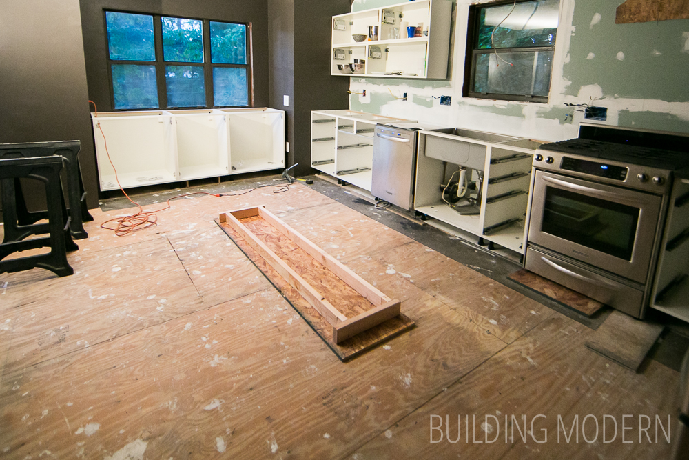 do you install kitchen cabinets before flooring hardwood floor installation for the kitchen amp foyer 14990